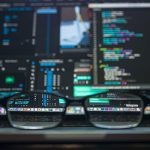 glasses out of focus in front of laptop