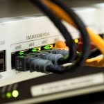 networking cables plugged into hardware